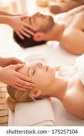 Caucasian couple on a head massage.