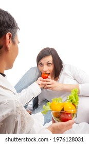 Caucasian Couple With Pregnant Wife Eating Fresh Vegetables on Glass Bowl Over White Background. Vertical Image - Shutterstock ID 1976128031