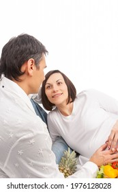 Caucasian Couple With Pregnant Wife Laying Together Over White Background. Vertical Image - Shutterstock ID 1976128028