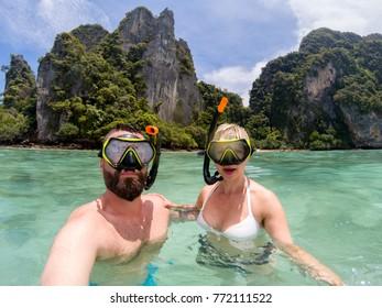 Caucasian couple snorkling on tourist tour on Phuket