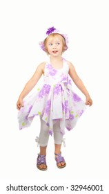 Caucasian cute little girl wearing a purple summer dress and heat dancing, isolated on white background.
