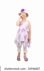 Caucasian cute little girl wearing a purple summer dress and heat starting Cray, isolated on white background.