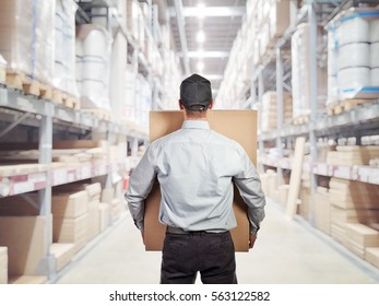 caucasian delivery man in warehouse