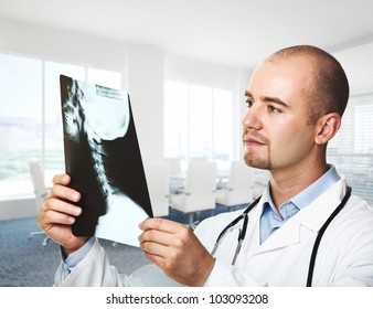 caucasian doctor look x-ray in office