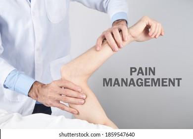 Caucasian doctor massaging patient hand. Pain management