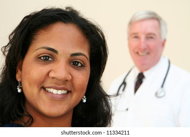 Caucasian Doctor with minority Nurse