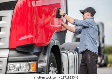 Caucasian Driver and His Euro Semi Truck. Preparing For the Next Destination.