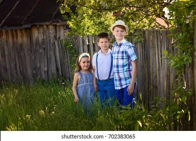 caucasian everyday children in the village. Three children portrait together in the summer