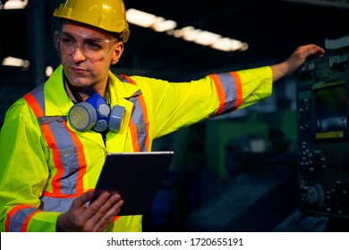 Caucasian factory man is working at the factory site. Factory worker concept. Top half of body composition.