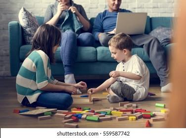 Caucasian family bonding kids playing