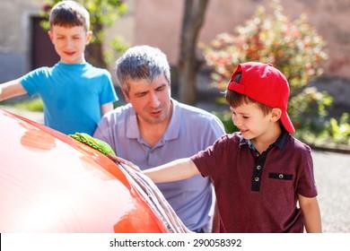 Caucasian family car wash on sunny day