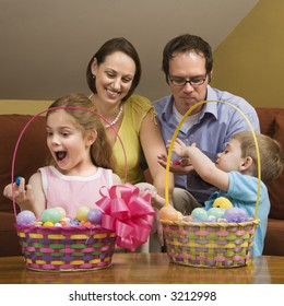 Caucasian family with looking at Easter baskets.