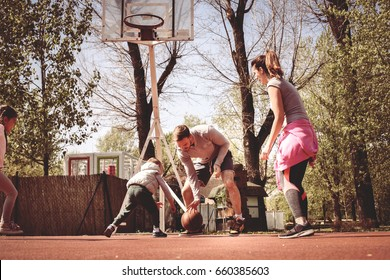 Caucasian family playing basketball together. Happy family spending free time together.