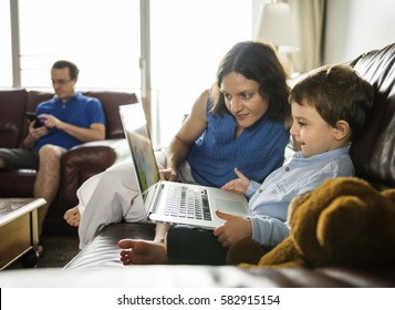 Caucasian Family Spend Time Holiday Together Using Laptop Relax