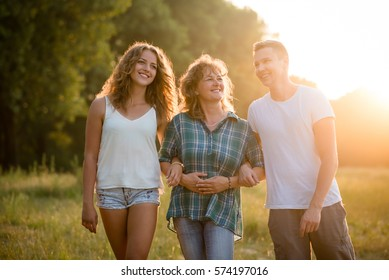 Caucasian family spending quality time outdoor during sunset