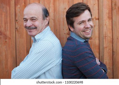 Caucasian father and adult son smiling and looking at camera. Concept of best family relationships