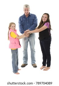 A caucasian father is with his two daughters. The family is happy together.