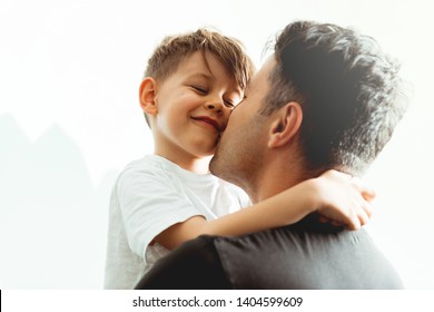 Caucasian Father and Son hugging