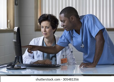 Caucasian female doctor and African American male nurse