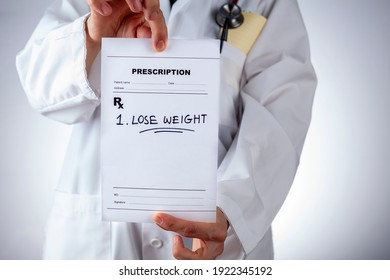 A caucasian female physician in white coat is prescribing Lose weight to an obese or overweight patient in her office. A concept image for lifestyle modifications, obesity, weight gain, problems,