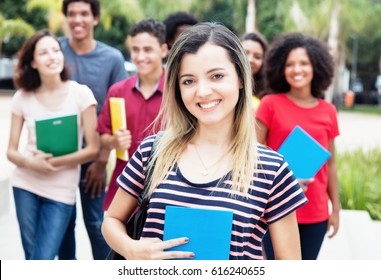 Caucasian female student with group of international students