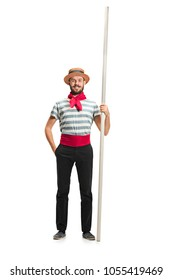 Caucasian funny bearded man in traditional gondolier costume and hat with paddle standing and posing at studio isolated on white background. Smiling young man. Human emotions, facial expression