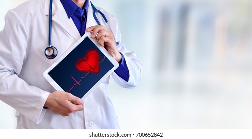 Caucasian general doctor showing tablet with electrocardiogram representation concept. Front position half body without head. Horizontal panoramic composition.