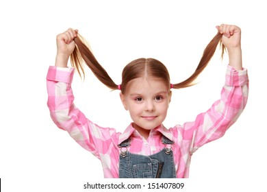 Caucasian girl in casual clothes with a fun hairstyle from the tails