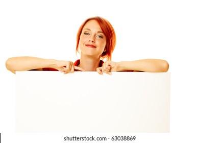 caucasian girl is holding a blank billboard