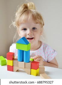 Caucasian Girl Playing with Wooden Colorful Cubes at Home Early Education Preparing for School Development