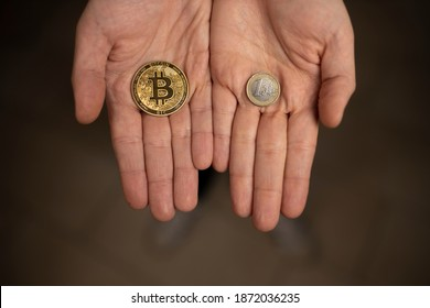 Caucasian hands shows one Bitcoin coin and one Euro Coin. New finance concept. Comparison between currencies, fiat and crypto. Two hands