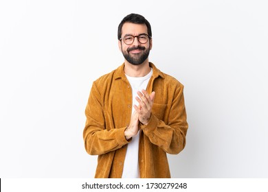 Caucasian handsome man with beard wearing a corduroy jacket over isolated white background applauding after presentation in a conference