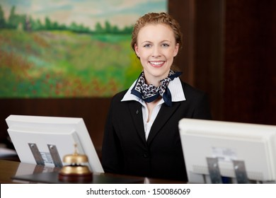 Caucasian happy woman working as a professional receptionist in a hotel