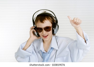 Caucasian happy young lad shows cool on a white background