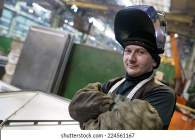 Caucasian industrial welder worker at factory workshop background