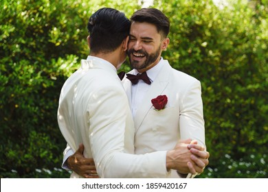caucasian lgbtq gay marriage couple having romantic moment together after wedding ceremony. Concept of LGBTQ same sex relation