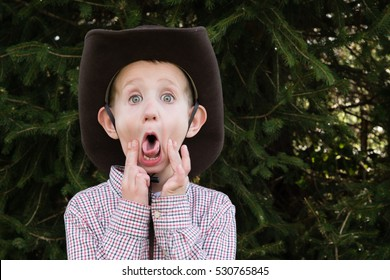 Caucasian little boy with cowboy hat sticking out tongue d2561b6f494