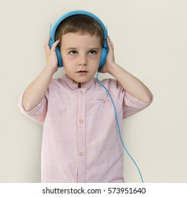 Caucasian Little Boy Trying Headphones