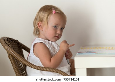Caucasian little girl at home, close up