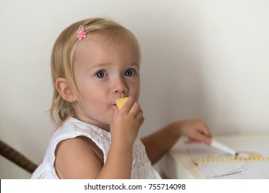 Caucasian little girl playing at home, close up