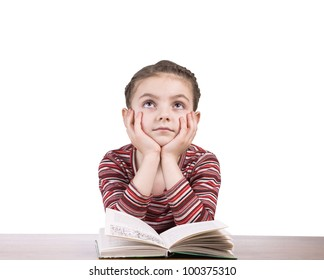 caucasian little girl is thinking or dreaming during preparing homework isolated on white background