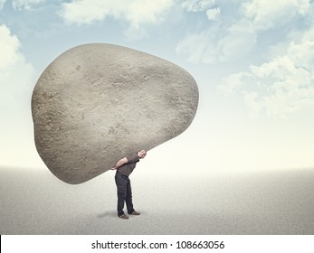 caucasian ma carry huge stone on his back