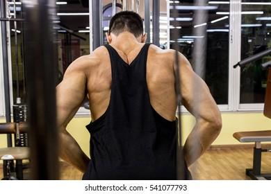 Caucasian male bodybuilder in gym