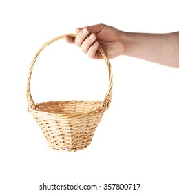 Caucasian male hand holding a wicker basket, composition isolated over the white background