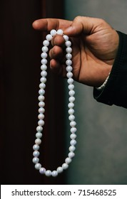 Caucasian male hand with a rosary indoor
