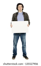 Caucasian male in his early 30's dressed in a casual attire and holding a large blank white sign, looking at the camera with a toothless. Isolated on white background.
