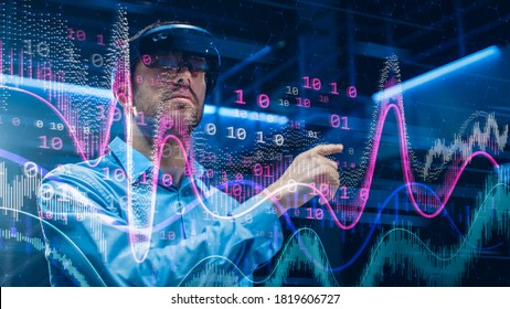 Caucasian Male IT Specialist and Businessman Wearing Futuristic VR Helmet and Working with Digital Data. Concept Shot of High Speed Internet Visualization and Graph Statistics in Foreground
