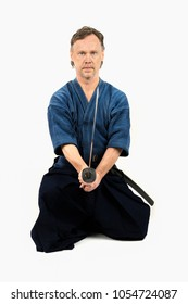 Caucasian male training Iaido, japanese sword sport. Sitting position.