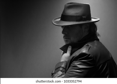 Caucasian Male in vintage trench coat and fedora. Black and white