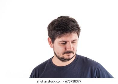 Caucasian man in black t-shit looks to down right corner